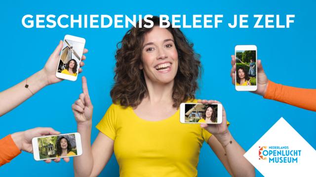 Jonge vrouw omringd door mobieltjes met afbeeldingen van haar in het Nederlands Openluchtmuseum